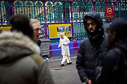 A worker at Smithfield Meat Market looks on as cast members of Phoenix Rising talk and hang out after rehearsals have finished.<br /> The full-scale production, which runs from 8th Nov - 2nd of Dec 2017 under Smithfield Meat Market, has been put together by charity The Big House, a charity that helps troubled youths who have been in care.