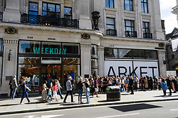 © Licensed to London News Pictures. 18/08/2017. London, UK. Customers queue for the opening of H&M group's first Weekday clothing store in Regent Street.   Weekday is know for its offerings and minimalist styles, with 27 stores throughout Europe. The store is next to the H&M Arket lifestyle store. Photo credit: Ray Tang/LNP