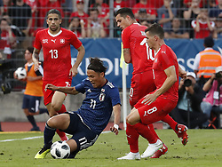 Switzerland's Ricardo Rodriguez (L) and Remo Freuler fight for the ball with Japans Takashi Usami during their friendly soccer match in the stadium Cornaredo in Lugano, southern Switzerland June 8, 2018. Switzerland won 2-0 against Japan. XINHUA/Ruben Sprich (Credit Image: © Ruben Sprich/Xinhua via ZUMA Wire)