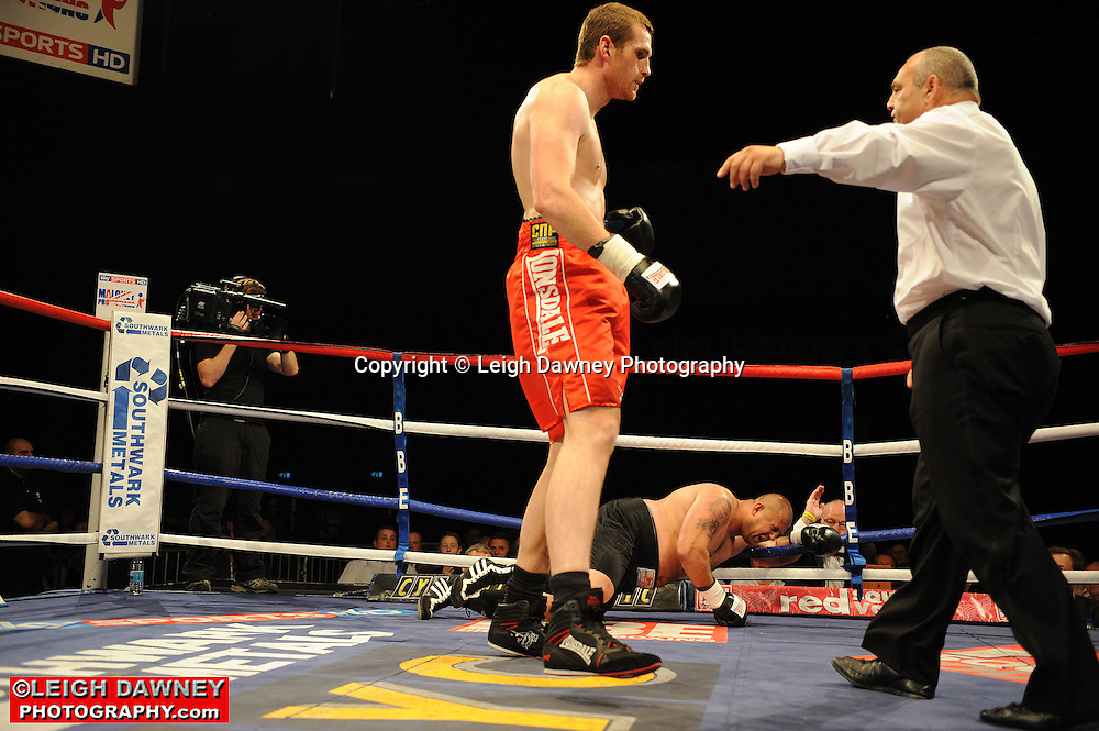 David Price (red shorts) defeats Pavol Polakovic at the Brentwood Centre on 25th June 2010.Frank Maloney Promotions. Photo credit: © Leigh Dawney