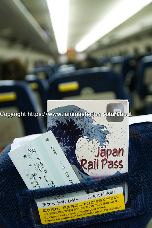 Rail ticket and Japan Rail Pass in ticket holder on a bullet train in Japan