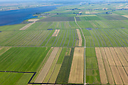 Nederland, Utrecht, Gemeente Eemnes, 06-09-2010; polders tussen Eemnes en Spakenburg gezien naar Flevoland. Een van de laatste open polderlandschappen in de Randstad. Het riviertje de Eem mondt uit in het Eemmeer.  De polders zijn: Zuidpolder te Veld, Noordpolder te Veld, Maatpolder Bikkerspolder..Polders between Eemnes and Spakenburg seen to Flevoland. One of the last open polder landscapes in the Randstad. The river Eem flows into the Eemmeer. .luchtfoto (toeslag), aerial photo (additional fee required).foto/photo Siebe Swart