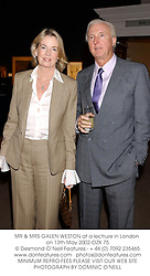 MR & MRS GALEN WESTON at a lectrure in London on 13th May 2002.	OZX 75