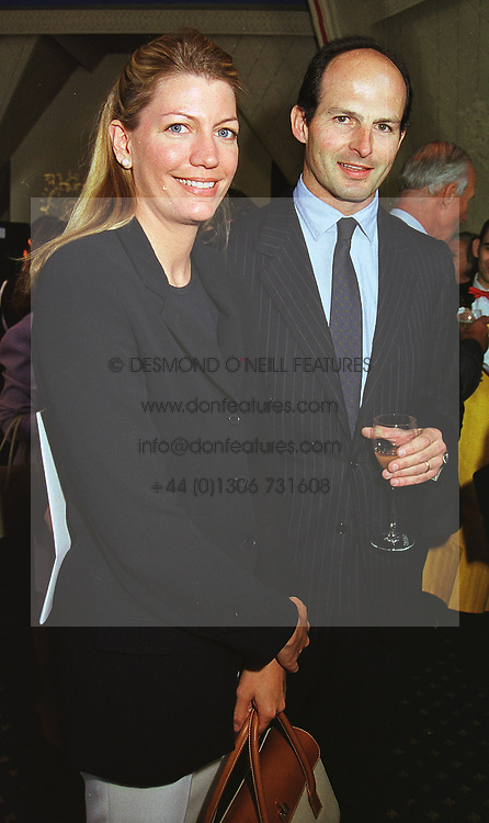 COUNT & COUNTESS PAVONCELLI at a reception in London on 20th May 1999.MSH 44