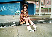A black teenage girl, wearing a tartan jacket and leg warmers, Bristol, 2002