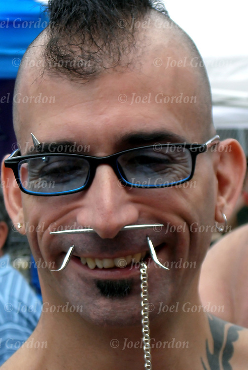 Folsom Street S&M Street Fair,portrait of man with non conforming piearcing and Mohawk hair cut