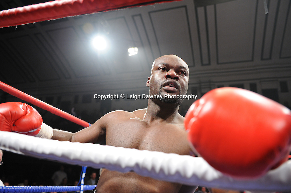 BBBofC Southern Area Heavyweight Title. Larry Olubamiwo holds onto the ropes during his fight with John McDermott at York Hall, Bethnal Green, London on the 19th February 2011. Frank Warren Promotions. Photo credit © Leigh Dawney.