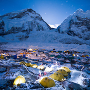 A busy night in Basecamp as evidenced by trails of headlamps coursing through tents along the Khumbu Glacier. The West Shoulder, Khumbu Icefall, and Nuptse rise behind.