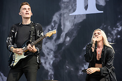 © Licensed to London News Pictures. 26/08/2017. Reading Festival 2017, Reading, UK. PVRIS perform on the main stage. Alex Babinski and  Lynn Gunn pictured  Photo credit: Andy Sturmey/LNP