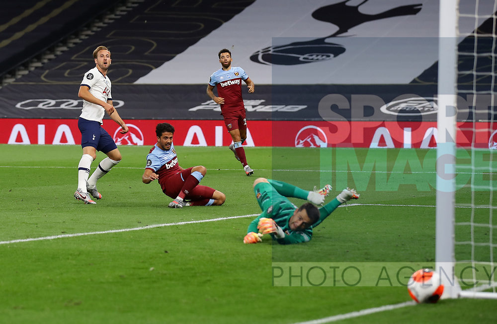 Harry Kane of Tottenham shoots wide past Lukasz Fabianski of West Ham United during the Premier League match at the Tottenham Hotspur Stadium, London. Picture date: 23rd June 2020. Picture credit should read: David Klein/Sportimage