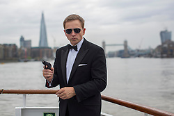 © licensed to London News Pictures. London, UK 22/08/2013. City Cruises launching their new Thamesjet, jet powered RIB, speedboat ride service with Tom Cruise, Arnold Schwarzenegger, a Daniel Craig lookalike on Thursday, 22 August 2013 in central London. Photo credit: Tolga Akmen/LNP