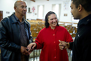 MANENBERG, SOUTH AFRICA - SEPTEMBER 15: From left, Irvin Smith, Natalie Smith and Edwin Joshua talk after Sunday morning services at The Parish of Reconciliation Anglican Church on September 15, 2013 in Manenberg, a township of Cape Town, South Africa. In August, 16 schools were closed in the area due to increasing gang violence. An uncertain peace has been brokered between the gangs to help the community resume their daily lives. Photo by Ann Hermes/The Christian Science Monitor