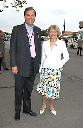The HON.HARRY HERBERT and his mother the DOWAGER COUNTESS OF CARNARVON at the King George VI and The Queen Elizabeth Diamond Stakes sponsored by De Beers held at Newbury Racecourse, Berkshie on 23rd July 2005.<br />