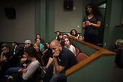"Students listen to ""      "" pose a question to the panel on September 11 at 6pm in the Athena."