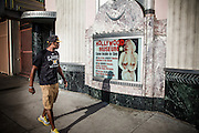 Los Angeles, April 9 2012- A passer-by looking at Marilyn Monroe on display in front of the Hollywood museum.