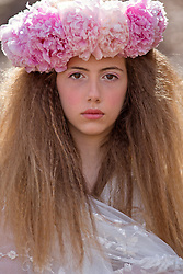Young Girl Wearing Flower Garland on Head