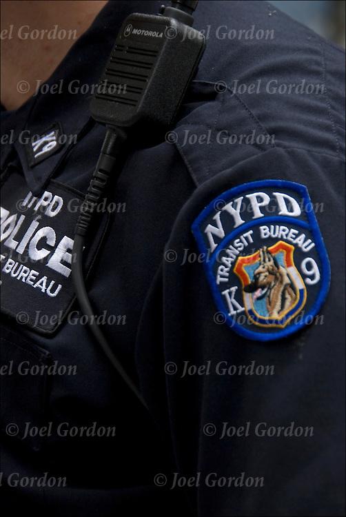 Close up of shoulder patch of NYPD Transit Bureau K-9 Unit on subway patrol.