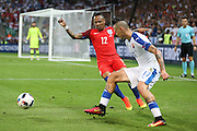 England Defender Nathaniel Clyne battles with Slovakia Midfielder Marek Hamsik during the Euro 2016 Group B match between Slovakia and England at Stade Geoffroy Guichard, Saint-Etienne, France on 20 June 2016. Photo by Phil Duncan.