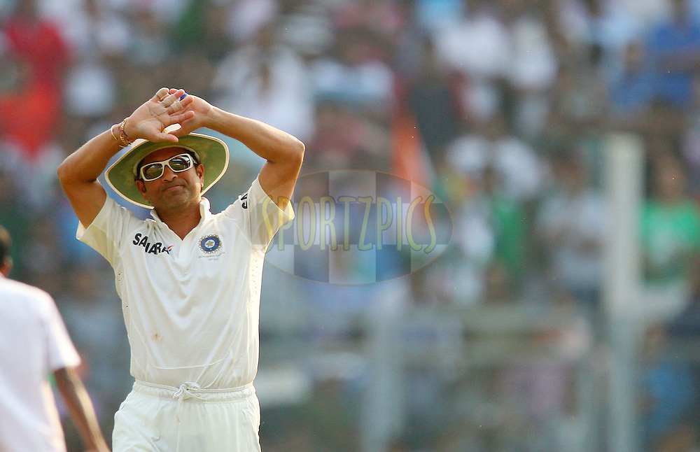 Sachin Tendulkar of India acknowledges the crowd during day two of the second Star Sports test match between India and The West Indies held at The Wankhede Stadium in Mumbai, India on the 15th November 2013<br /> <br /> This test match is the 200th test match for Sachin Tendulkar and his last for India.  After a career spanning more than 24yrs Sachin is retiring from cricket and this test match is his last appearance on the field of play.<br /> <br /> <br /> Photo by: Ron Gaunt - BCCI - SPORTZPICS<br /> <br /> Use of this image is subject to the terms and conditions as outlined by the BCCI. These terms can be found by following this link:<br /> <br /> http://sportzpics.photoshelter.com/gallery/BCCI-Image-Terms/G0000ahUVIIEBQ84/C0000whs75.ajndY