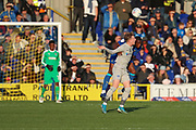 AFC Wimbledon defender Paul Kalambayi (30) winning header during the EFL Sky Bet League 1 match between AFC Wimbledon and Portsmouth at the Cherry Red Records Stadium, Kingston, England on 19 October 2019.