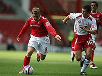 Photo: Rich Eaton. <br /> <br /> Nottingham Forest v AFC Bournemouth. Coca Cola Championship. 11/08/2007. Forest's Kris Commons (l) attacks chased by Bournemouths Jason Pearce (r).