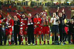 CARDIFF, WALES - Sunday, March 2, 2003: Liverpool's players (l-r Jamie Carragher, El-Hadji Diouf, Phil Thompson, Steven Gerrard, John Arne Riise and Jerzy Dudek) celebrate winning the League Cup after beating Manchester United 2-0 in the Football League Cup Final at the Millennium Stadium. (Pic by David Rawcliffe/Propaganda)
