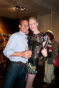 ROBERT FAIRER; JADE PARFITT, Vogue: Fashion's Night Out: Armani. Bond st.  London. 8 September 2010.  -DO NOT ARCHIVE-© Copyright Photograph by Dafydd Jones. 248 Clapham Rd. London SW9 0PZ. Tel 0207 820 0771. www.dafjones.com.