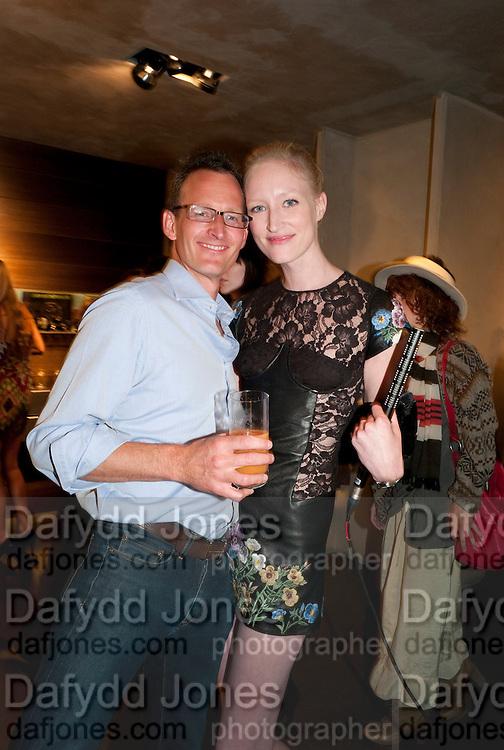 ROBERT FAIRER; JADE PARFITT, Vogue: Fashion's Night Out: Armani. Bond st.  London. 8 September 2010.  -DO NOT ARCHIVE-© Copyright Photograph by Dafydd Jones. 248 Clapham Rd. London SW9 0PZ. Tel 0207 820 0771. www.dafjones.com.