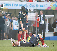 Laurent Koscielny of France (L) comforts Mathieu Debuchy of France  after losing 0-1 during the 2014 FIFA World Cup match between France and Germany at the Maracana Stadium, Rio de Janeiro<br /> Picture by Andrew Tobin/Focus Images Ltd +44 7710 761829<br /> 04/07/2014