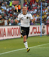 Lukas Padolski Celebrates Scoring 2nd Goal<br /> Germany World Cup 2010<br /> Germany V England 27/06/10 Round Of 16<br /> FIFA World Cup 2010<br /> Photo Robin Parker Fotosports International