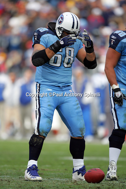 NASHVILLE, TN - DECEMBER 3:  Center Kevin Mawae #68 of the Tennessee Titans stands over the ball at the line of scrimmage against the Indianapolis Colts at LP Field on December 3, 2006 in Nashville, Tennessee. The Titans defeated the Colts 20-17. ©Paul Anthony Spinelli *** Local Caption *** Kevin Mawae