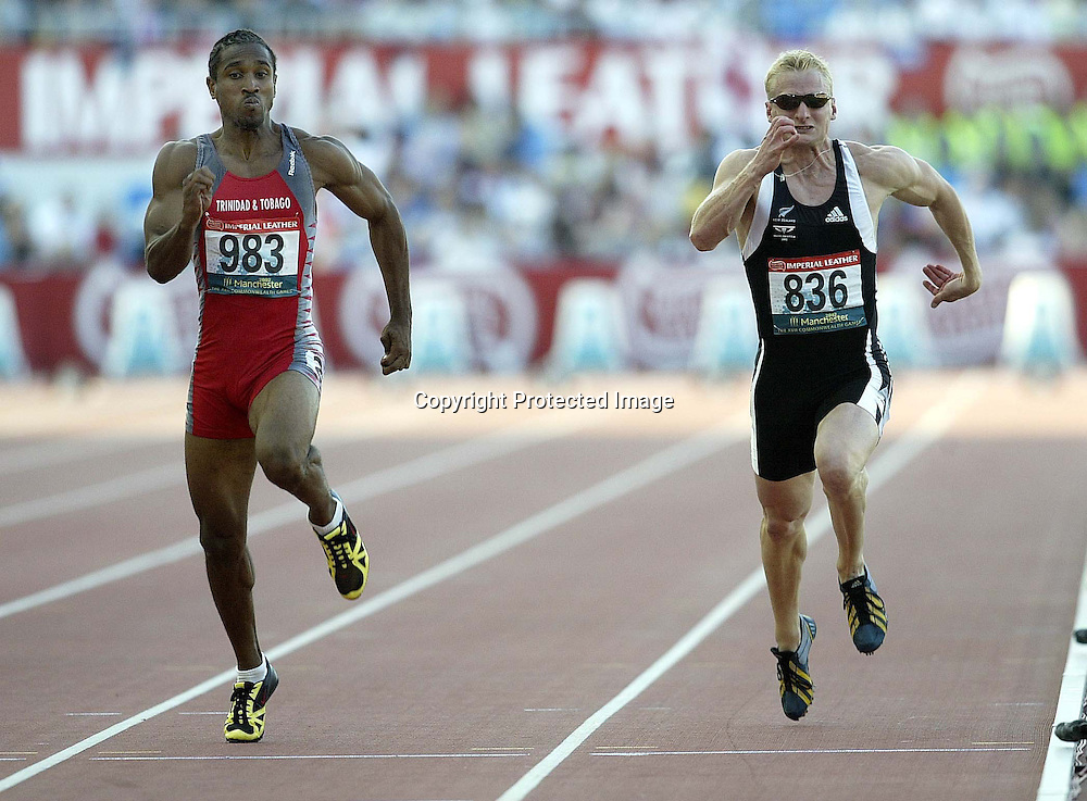 26 July 2002, Manchester stadium , Sportcity,  Commonwealth Games, Manchester, England.<br />100m 2nd round  Jacey Harper (Trinidad L) Dallas Roberts NZ <br />Pic: Anthony Phelps/Photosport