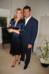 TV presenter GABBY LOGAN and her husband KENNY LOGAN at an evening with racing driver Lewis Hamilton held at The Hempel Hotel, 31-35 Craven Hill Gardens, London W2 on 4th July 2007.<br /><br />NON EXCLUSIVE - WORLD RIGHTS