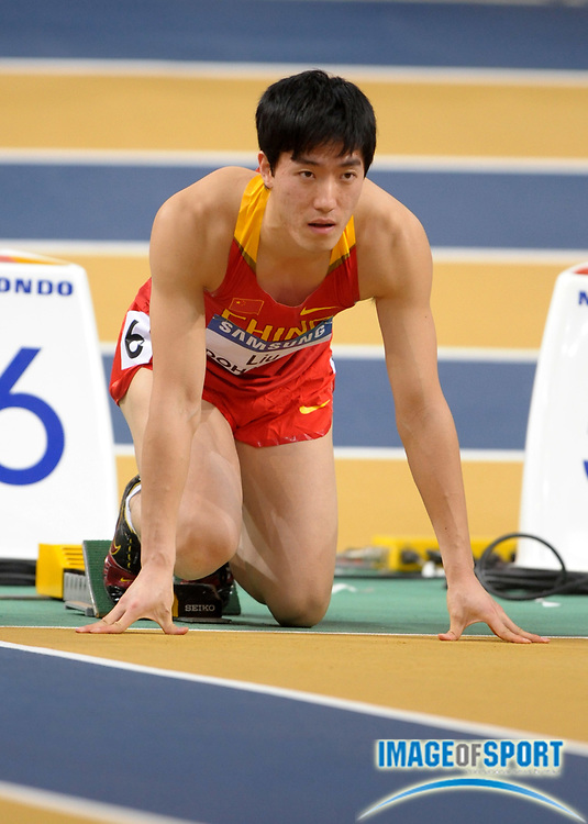 Mar 12, 2010; Doha, QATAR; Xiang Liu (CHN) in the starting blocks of a 60m hurdle heat in the IAAF World Indoor Championships in Athletics at the Aspire Dome.
