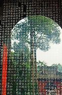 Wu Hou Shrine, Chengdu, China. The famous Tang Tablet stone calligraphy stele. The temple garden reflected in the cover glass