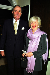 MR JOHN CHALK and MISS LIBBY REEVES PURVIS, at a party in London on 29th September 1999.MWX 38