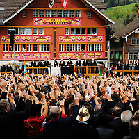 Citizens voting by a show of hands in the annual Landsgemeide (Cantonal Assembly) in the Landsgeimdeplatz. Appenzell is a distinctly traditional canton, one of the last remaining places where this direct form of democracy is still used, with which there is no anonymity. Women only received the right to vote in 1990, and only then, by imposition from the Swiss Federal Government. Men carry swords as symbols of their right to vote.