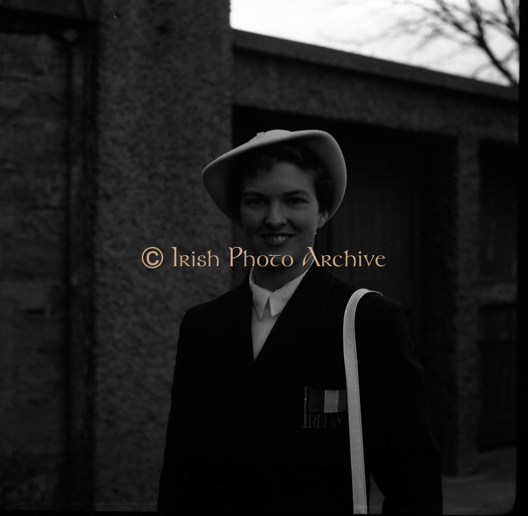 Maeve Kyle - Leaves for Olympics in Melbourne.26/11/1956..Maeve Esther Enid Kyle, OBE, née Shankey, (06/10/1928, County Kilkenny), is an Irish Olympic athlete and hockey player. She competed in the 100m and 200m in the Melbourne Olympics and subsequently in the Rome Olympics and Tokyo Olympics (where she reached the semi-finals of both the 400m and 800m). She took bronze in the 400m at the 1966 European Indoor Athletics Championships in Dortmund..In hockey, she gained 58 Irish caps as well as representing three of the four Irish provinces (Leinster, Munster and Ulster) at different stages of her career. She was named in the World All Star team in 1953 and 1959. .She was also a strong competitor in tennis, swimming, sailing and cricket and now works as a coach to many athletes. She is chair of Coaching NI. In 2006 she was awarded the honorary degree of Doctor of the University (DUniv) from the University of Ulster. .Maeve Kyle was awarded the Lifetime Achievement Award at the 2006 Coaching Awards in London in recognition of her work with athletes at the Ballymena and Antrim Athletics Club. Earlier in 2006 she was one of 10 players who were initially installed into Irish hockey's Hall of Fame. .She was appointed Officer of the Order of the British Empire (OBE) in the 2008 New Year Honours..