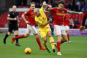 MK Dons midfielder Samir Carruthers uses his strength during the Sky Bet Championship match between Nottingham Forest and Milton Keynes Dons at the City Ground, Nottingham, England on 19 December 2015. Photo by Aaron Lupton.