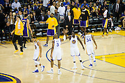 The Golden State Warriors high five eachother during a Los Angeles Lakers timeout at Oracle Arena in Oakland, Calif., on November 23, 2016. (Stan Olszewski/Special to S.F. Examiner)