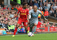 Raheem Sterling of Liverpool and Yoan Gouffran of Newcastle United in action during the Barclays Premier League match at Anfield, Liverpool.<br /> Picture by Michael Sedgwick/Focus Images Ltd +44 7900 363072<br /> 11/05/2014