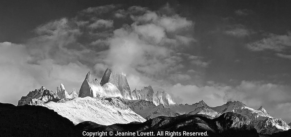 Stitched Panoramic of Tierra del Fuego, Torres Del Plaine National Park. Patagonia, Argentina, Fitzroy spires rise into the cloudscape.