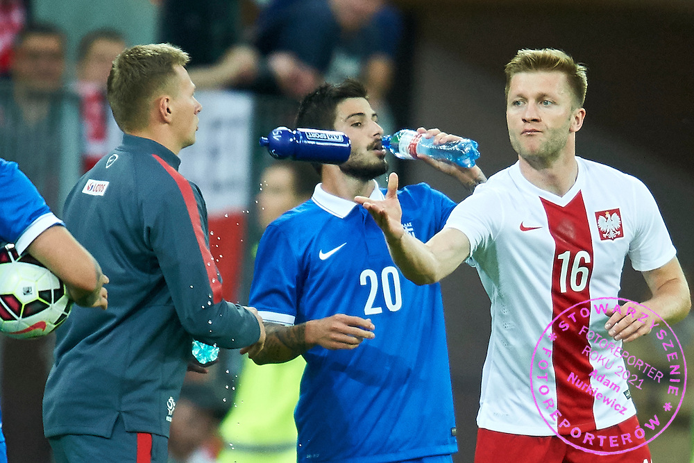 (R) Jakub Blaszczykowski from Poland returns bottle of water during international friendly soccer match between Poland and Greece at PGE Arena Stadium on June 16, 2015 in Gdansk, Poland.<br /> Poland, Gdansk, June 16, 2015<br /> <br /> Picture also available in RAW (NEF) or TIFF format on special request.<br /> <br /> For editorial use only. Any commercial or promotional use requires permission.<br /> <br /> Adam Nurkiewicz declares that he has no rights to the image of people at the photographs of his authorship.<br /> <br /> Mandatory credit:<br /> Photo by &copy; Adam Nurkiewicz / Mediasport
