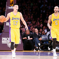 04 November 2014: Los Angeles Lakers guard Jeremy Lin (17) brings the ball up court next to Los Angeles Lakers forward Carlos Boozer (5) during the Phoenix Suns 112-106 victory over the Los Angeles Lakers, at the Staples Center, Los Angeles, California, USA.