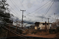 An impoverished neighborhood in Nogales where many steal electricity, have no water, and work in the foreign run factories.