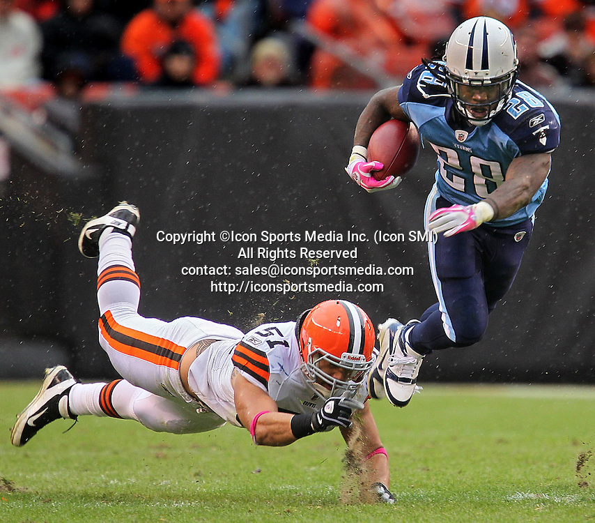 Oct. 2, 2011 - Cleveland, Ohio, U.S.- The Tennessee Titans' CHRIS JOHNSON, right, gets away from a diving Cleveland Browns linebacker CHRIS GOCONG in the fourth quarter at Cleveland Browns Stadium. The Titans defeated the Browns, 31-13