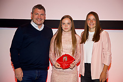 NEWPORT, WALES - Saturday, May 19, 2018: Erin Lovett is presented with her Under-16's cap by Osian Roberts (left) and Lauren Dykes (right) during the Football Association of Wales Under-16's Caps Presentation at the Celtic Manor Resort. (Pic by David Rawcliffe/Propaganda)