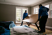 Reynolds Transfer & Storage employees are seen moving the homeowner's belongings during a move in Madison, Wisconsin on January 27, 2020.<br /> <br /> Beth Skogen Photography<br /> www.bethskogen.com