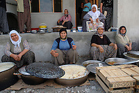 Traditional celebration foodmeal for worker's son joining the forces Agricultural workers in small town of Yesilkoy
