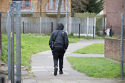 © Licensed to London News Pictures. 20/03/2017. London, UK. A youth walks through St Ann's near the scene of a fatal shooting in Barking, east London, where an 18 year old man was shot in the head on Sunday evening. Photo credit: Peter Macdiarmid/LNP